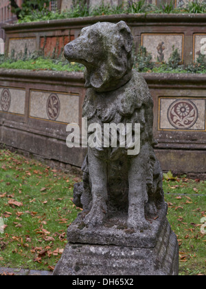 Statue to a dog in the grounds of St. Pancras Old church in London, UK - Stock Photo
