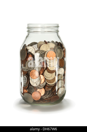 An open glass jar filled with loose coins - US currency - Stock Photo