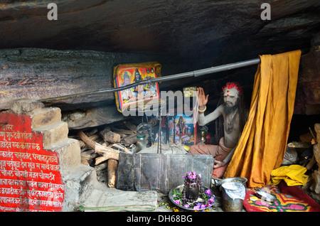 Sadhu lives in a cave near Mana village, India - Stock Photo