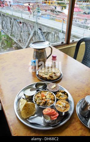 Indian traditional food Thali, restaurant in Badrinath, Uttarakhand, India - Stock Photo