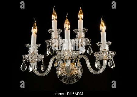 Contemporary glass chandelier isolated over black background - Stock Photo