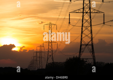 Electricity pylons at sunset, Nr Hinkley Point, Somerset - Stock Photo