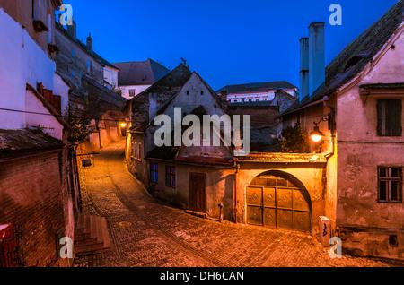 Sibiu, town in Transylvania, Romania. Old street of residential buildings - Stock Photo