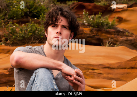 Young man resting during a hiking trip - Stock Photo