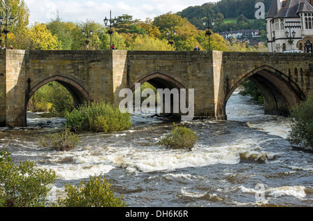 Arched Stone Dee Bridge over the River Dee at Llangollen North Wales - Stock Photo