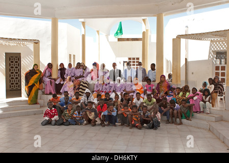 Students and teachers assembled in courtyard at school for disadvantaged and abandoned children, Nouakchott, Mauritania - Stock Photo