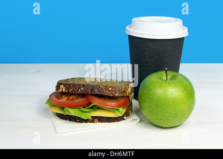 healthy lunch with sandwich, green apple and coffee in paper cup - Stock Photo