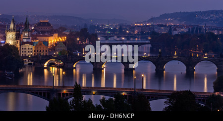 View to Prague bridges over Vltava river in the evening - Stock Photo