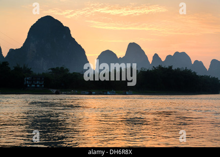 Sunset on the Li River near Xingpin village in China - Stock Photo