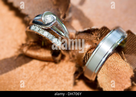 Wedding rings abstract with brown pillow decorated with jewel. - Stock Photo
