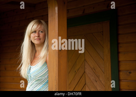 girl standing near house in the village - Stock Photo