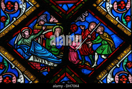 Stained glass window depicting Joseph, Mother Mary and Jesus in the cathedral of Caen, France - Stock Photo