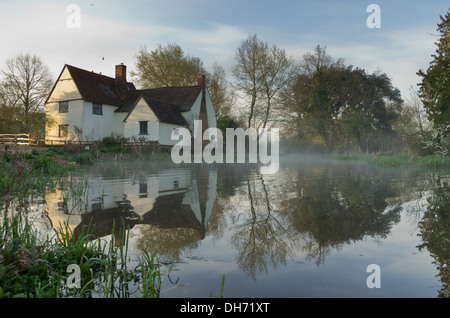 Classic Constable  painting scene at Flatford Mill with mist and refelction - Stock Photo