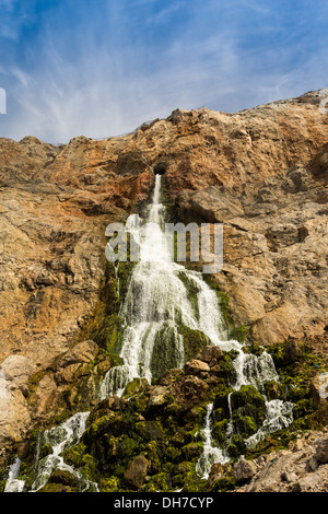 A LARGE WATERFALL FROM THE ROCK FACE IN GIBRALTAR AN OUTFLOW FROM THE DESALINATION PLANT ON THE TOP OF THE CLIFFS - Stock Photo