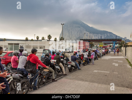 BORDER CROSSING FROM  LA LINEA SPAIN INTO GIBRALTAR  A TRAFFIC QUEUE WITH THE  ROCK IN THE BACKGROUND - Stock Photo