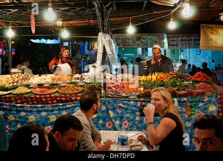 Food Night Market Jamaa el Fna is a square and market place in Marrakesh's Medina quarter (old city) Morocco - Stock Photo
