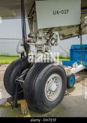 Landing wheels of a jumbo jet airliner - Stock Photo