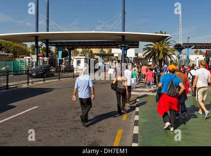 PEDESTRIANS CROSSING THE BORDER FROM GIBRALTAR INTO SPAIN AT LA LINEA - Stock Photo
