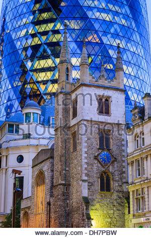 Gherkin 30 St Marys Axe with St Andrew Undershaft Church London England - Stock Photo