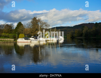 Boats moored at the Swan Hotel Marina, on the River Leven, Newby Bridge, Lake District National Park, Cumbria, England - Stock Photo