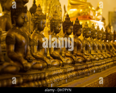 Row of sitting Buddha statues at Wat Chedi Luang temple in Chiang Mai, Thailand. - Stock Photo