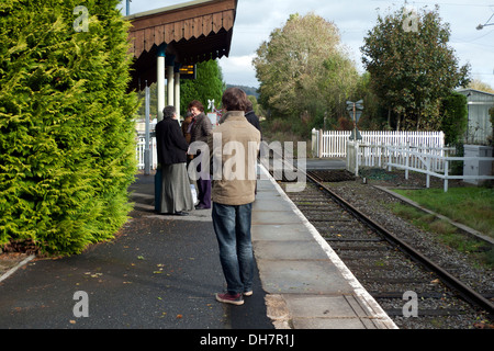 People waiting on Heart of Wales line platform for train to Swansea  at Llanwrda station Carmarthenshire Wales UK - Stock Photo