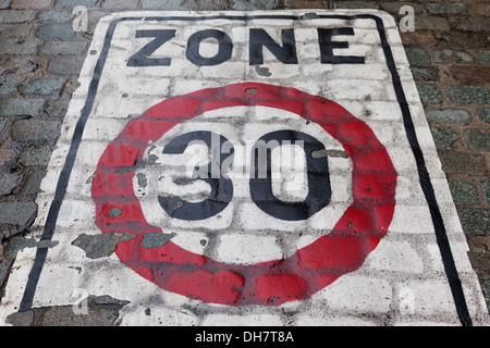 Zone 30, traffic speed regulated zone, sign on cobblestones, Brussels, Belgium - Stock Photo