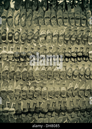 Foot wears on display outside a shop, India - Stock Photo
