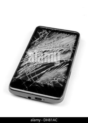 Cracked, broken, damaged smart phone - cell phone - Stock Photo