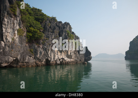 Spectacular limestone karst formations in Lan Ha Bay, Ha Long Bay, Vietnam. - Stock Photo