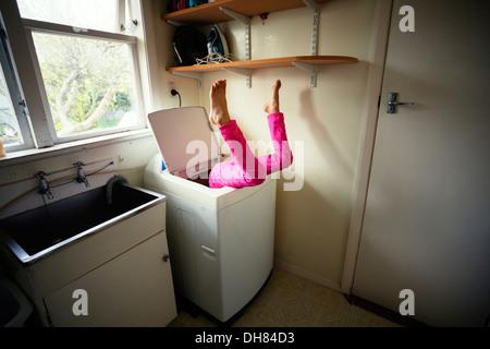 Laundry room accident - Stock Photo