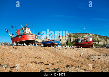 Fishing boats on Hastings beach in front of East Cliff Lift - Stock Photo