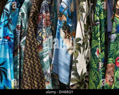 Hawaiian shirts hanging on a rail close up - Stock Photo