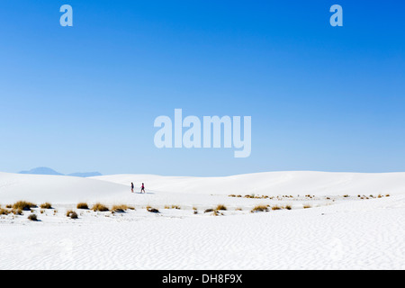 Walkers on the dunes at White Sands National Monument, near Alamogordo, New Mexico, USA - Stock Photo