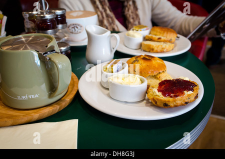 Afternoon tea with fresh scones in an English tearoom - Stock Photo