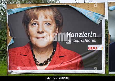 German Chancellor Angela Merkel billboard from German general elections 2013. - Stock Photo