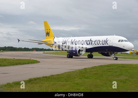 Monarch Airlines Airbus A320-200 taxiing to terminal - Stock Photo
