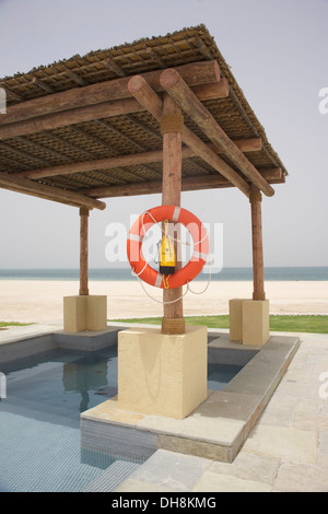 Pool area at new beach villa resort Sir Bani Yas Island, Abu Dhabi - Stock Photo
