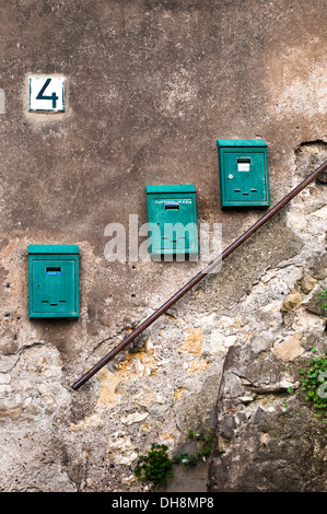 Three letter boxes on a dilapidated wall, Tivoli, Italy - Stock Photo