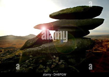 Sunset through  rock stack, on Roughtor sadle back mountain - Stock Photo