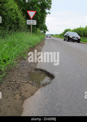 With a recent survey showing that two thirds of UK motorists encounter between one and five potholes every day. - Stock Photo