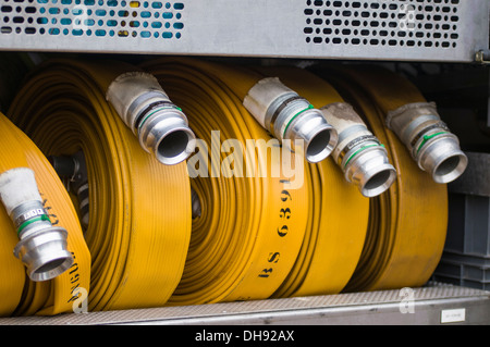 Fire hoses in the back of a fire engine - Stock Photo