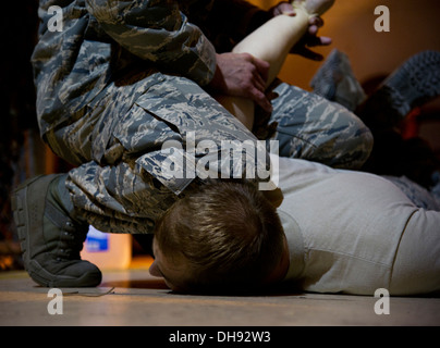 Staff Sgt. William Mack, 91st Security Support Squadron tactical response force member demonstrates how to restrain - Stock Photo