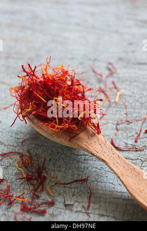 Still Life Of Saffron On Wooden Spoon - Stock Photo