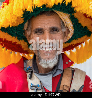 Portrait Of A Man With A Large Colourful Hat; Marrakesh, Marrakech-Tensift-El Haouz, Morocco - Stock Photo