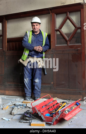 Joiner standing by his tools and wooden door, Glasgow,Scotland, UK, Great Britain - Stock Photo