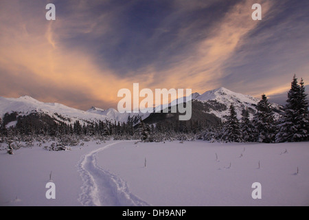 Sunrise over winter landscape with mountains in the snow, Alps, Austria - Stock Photo
