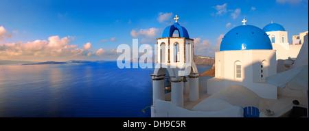 Oia, ( Ia ) Santorini - Blue domed Byzantine Orthodox churches, - Greek Cyclades islands - Stock Photo