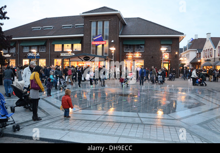 evening shopping at McArthur Glen Designer Outlet Center Roermond Netherlands - Stock Photo