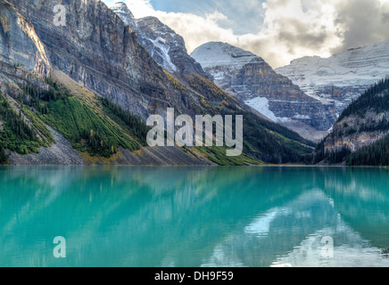 Mountains and glaciers reflected in the idyllic azure glacial waters of Lake Louise, Alberta, Canada